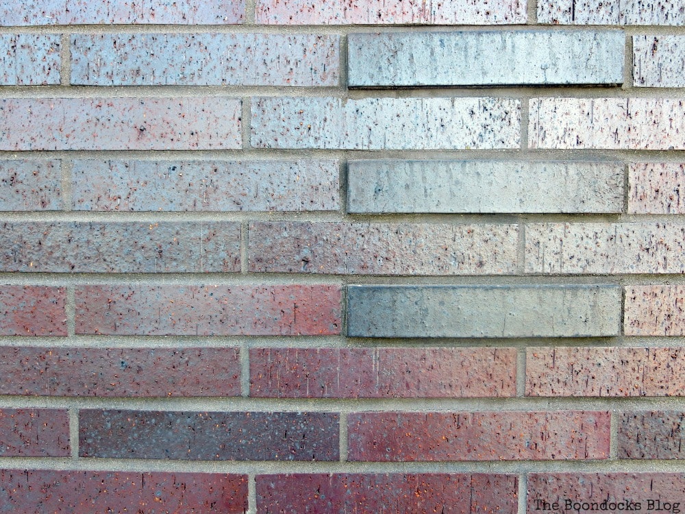 Maroon masonry base of building, A monumental Surprise at Hudson Square in New York, www.theboondocksblog.com