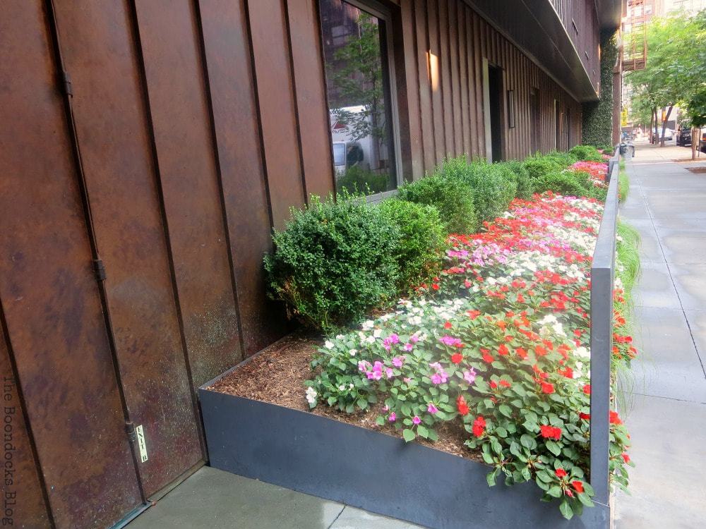 Flower bed in front of residential building, A monumental Surprise at Hudson Square in New York, www.theboondocksblog.com