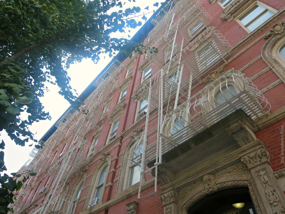 Typical building with ornate features and fire escapes, A monumental Surprise at Hudson Square in New York, www.theboondocksblog.com