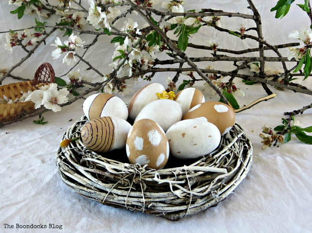 Vine wreath repurposed into egg holder centerpiece for Spring, 35 Easy Spring Ideas to Inspire You www.theboondocksblog.com