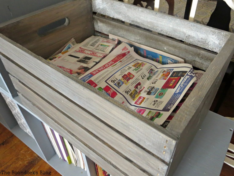 Crate filled with flyers and newspapers, How to get a stunning finish on a wood crate with stain www.theboondocksblog.com