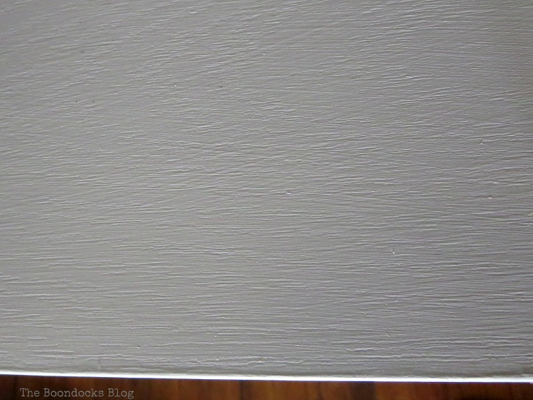 Detail of paint finish on laminate, How to Repaint Cubby Storage Units the Easy Way www.theboondocksblog.com