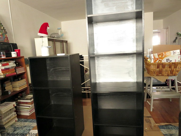 one coat of paint on black cubby storage