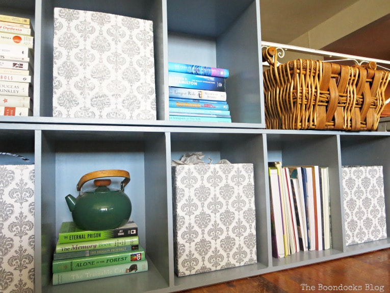 Cardboard boxes serving as storage cubes, How to Repaint Cubby Storage Units the Easy Way www.theboondocksblog.com