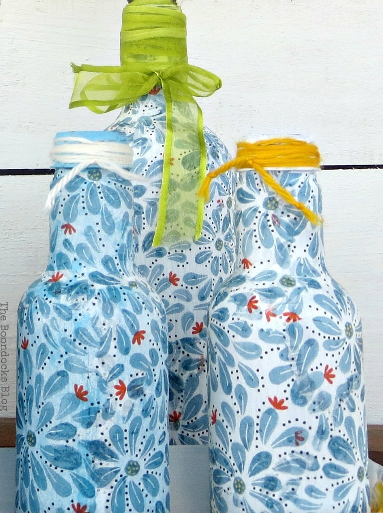 Plastic bottles decoupaged with napkins