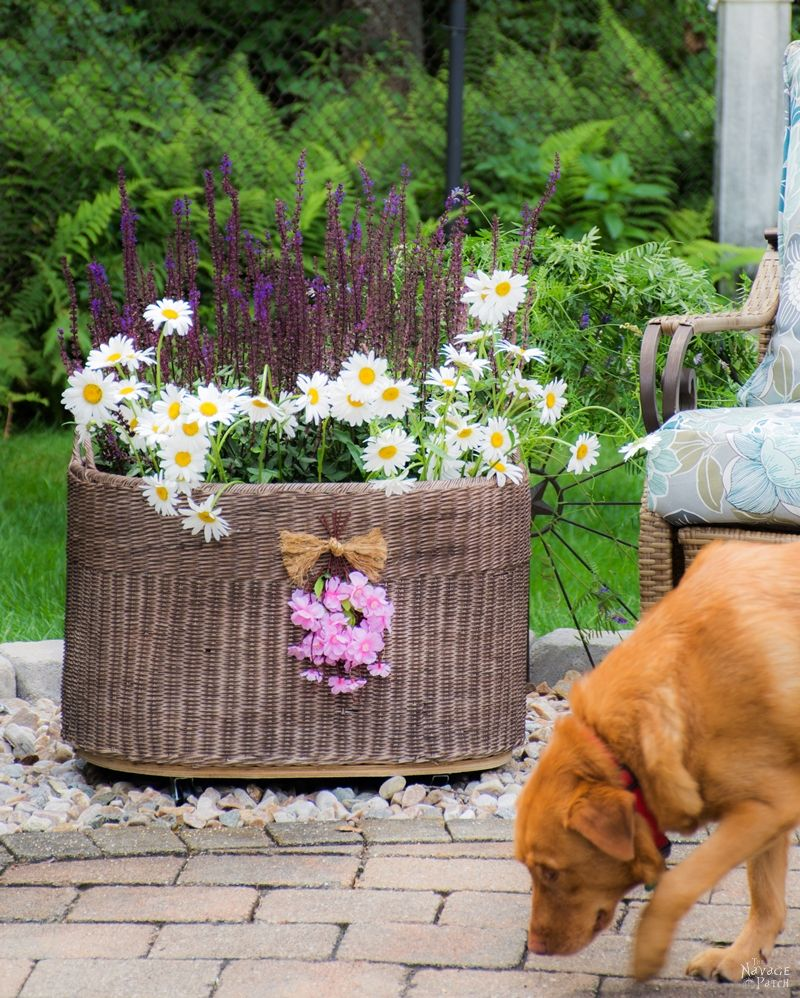 Basket planter with casters, 35 Easy Spring Ideas to Inspire You www.theboondocksblog.com