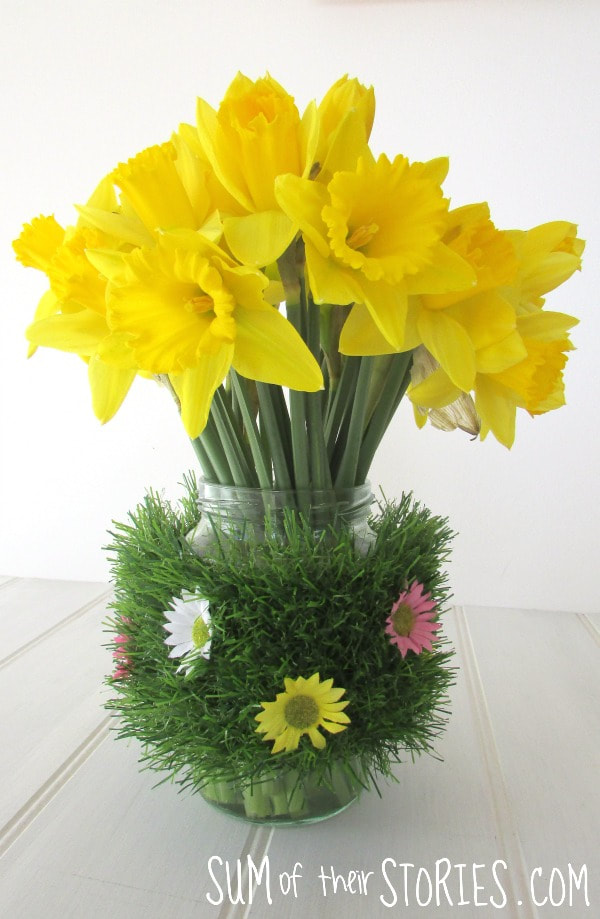 Faux grass and flowers vase, 35 Easy Spring Ideas to Inspire You www.theboondocksblog.com