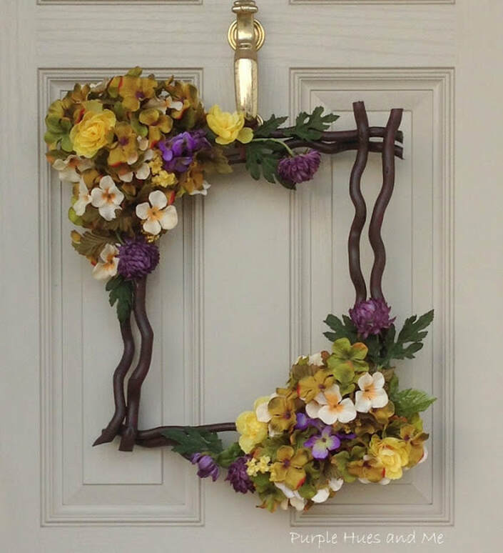 Unique spring wreath with vines and flowers, 35 Easy Spring Ideas to Inspire You www.theboondocksblog.com