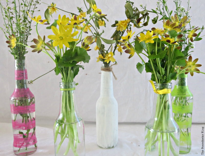 glass bottles painted with nail polish and chalky finish paint