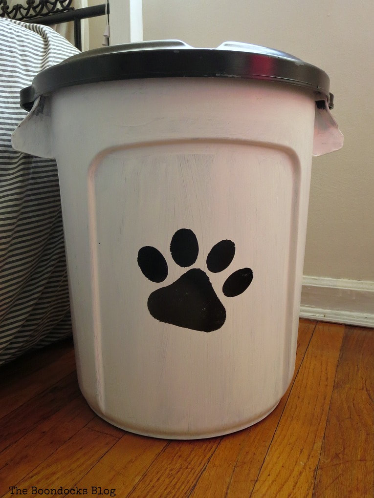 Painted plastic bucket made into a dog food storage container.
