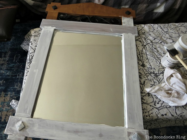 Painting the mirror with chalky finish paint in white, How to Makeover a Curbside Mirror the Lazy Way www.theboondocksblog.com