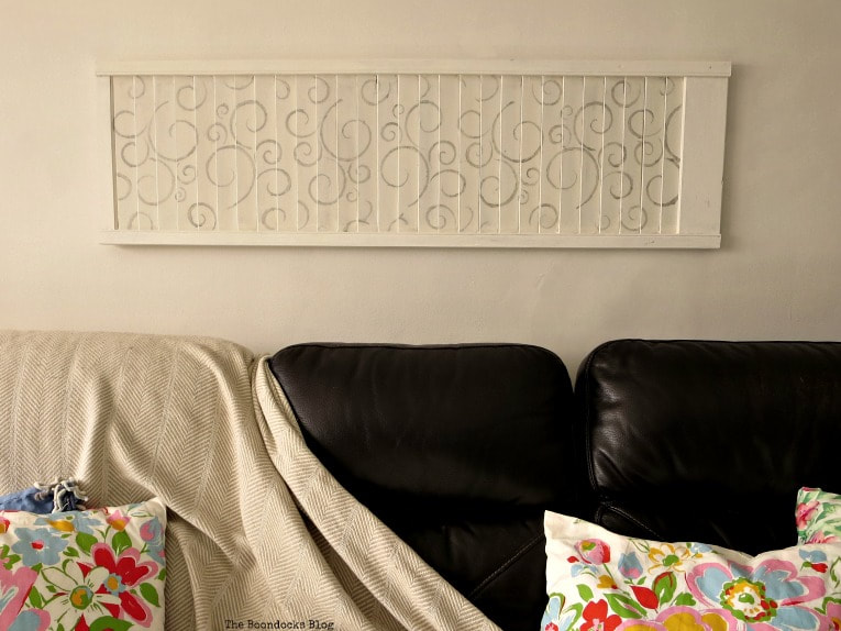 Stenciled shutter above sofa, #shutterart #stenciledshutter #chalkyfinishpaint #DecoArtMedia #DIYArt #Stenciledswirls How to Make Shutter Art with a Stencil the Wrong Way www.theboondocksblog.com