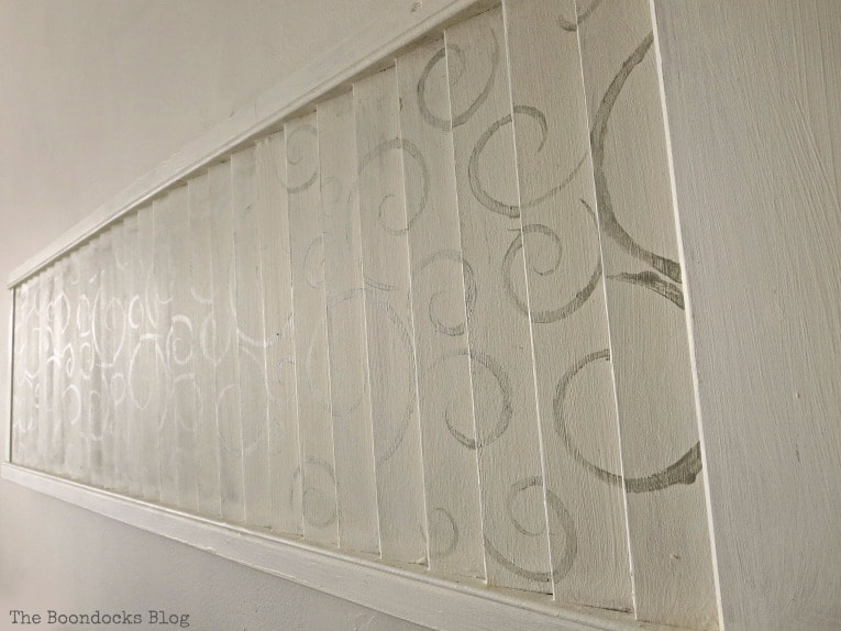 Looking at metallic finish of the stenciled shutter, How to Make Shutter Art with a Stencil the Wrong Way www.theboondocksblog.com