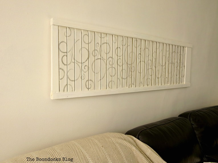 Stenciled shutter art above sofa, #shutterart #stenciledshutter #chalkyfinishpaint #DecoArtMedia #DIYArt #Stenciledswirls How to Make Shutter Art with a Stencil the Wrong Way www.theboondocksblog.com