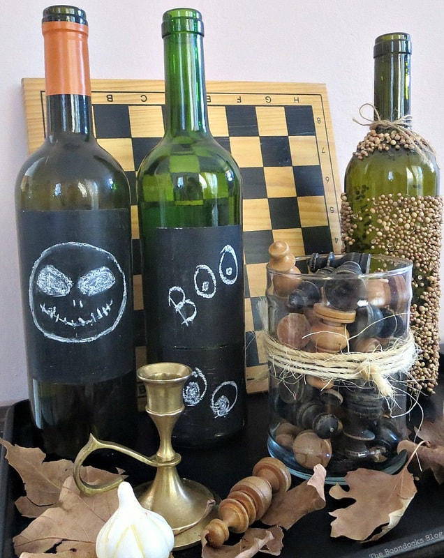 Chalkboard label bottles, 15 Household Items Re-purposed for Halloween Decor www.theboondocksblog.com