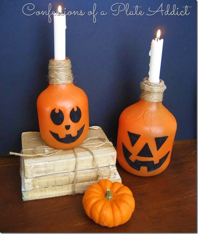 Juice bottles as Jack O Lanterns from Confessions of a Plate Addict. 15 Household Items Re-purposed for Halloween Decor www.theboondocksblog.com