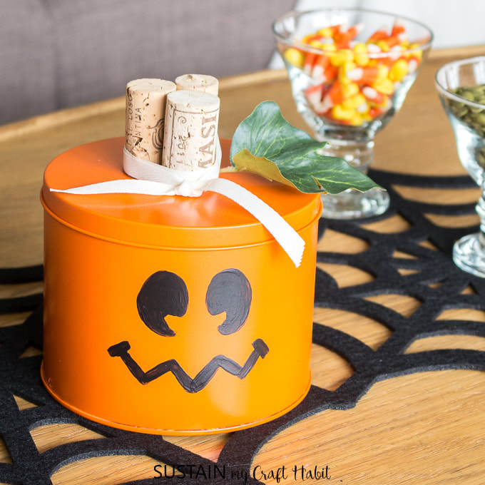Tin Can Jack O Lantern from Sustain My Craft, 15 Household Items Re-purposed for Halloween Decor www.theboondocksblog.com