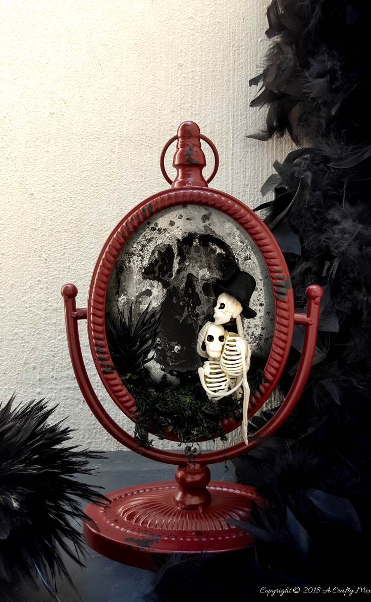 Ghost mirror Halloween Decor from A Crafty Mix, 15 Household Items Re-purposed for Halloween Decor www.theboondocksblog.com
