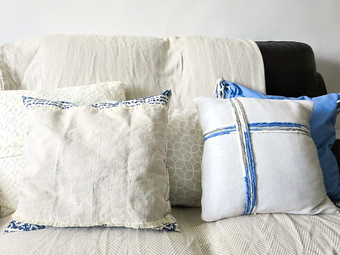 5 pillows made with fabric remnants of old clothes and sheets, How to Make Easy Pillows out of Fabric Remnants 5 ways www.theboondocksblog.com