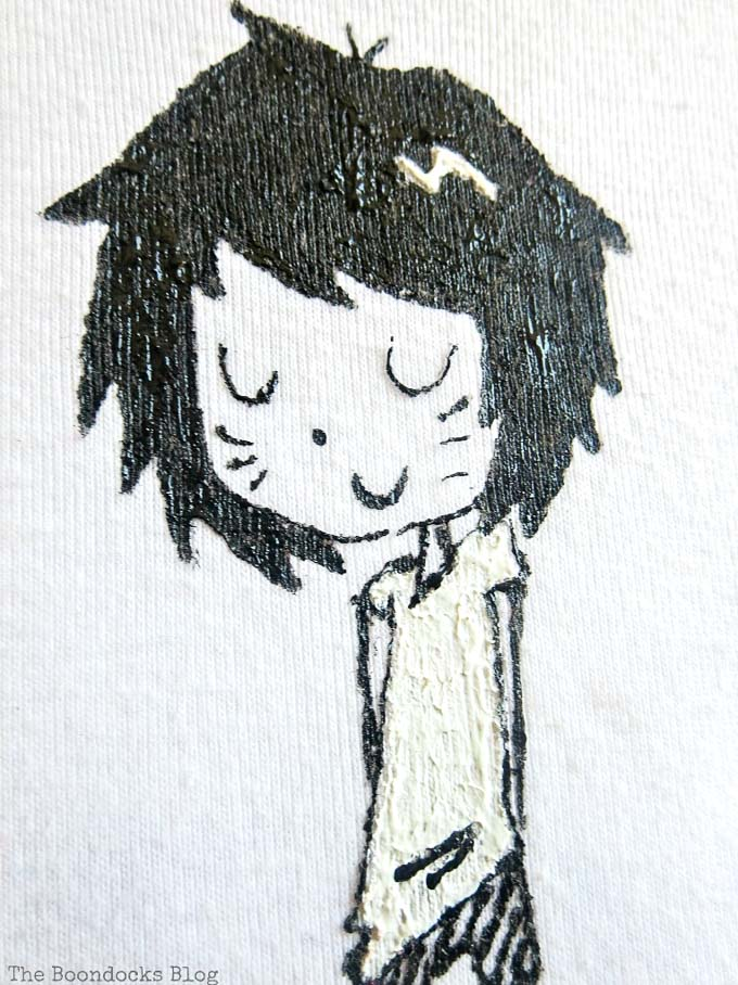 Close up of the girl character drawing on a white tshirt.