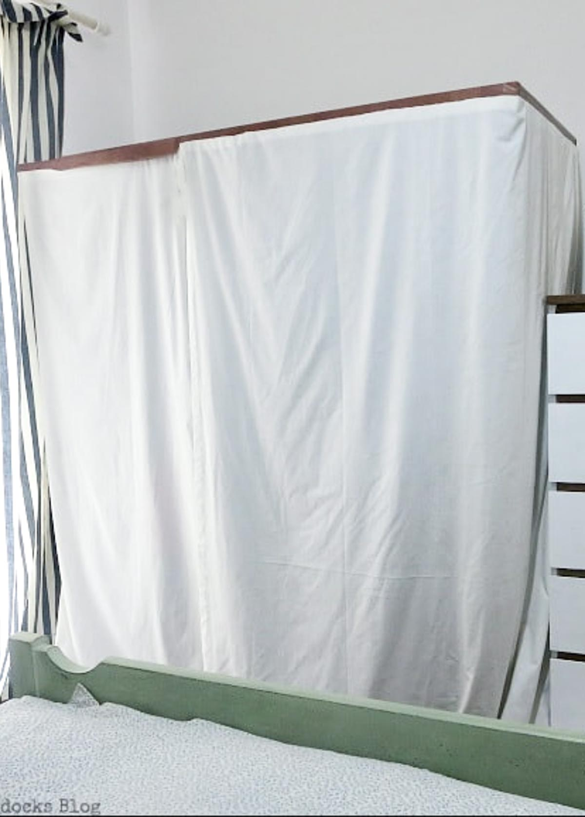 Clothes rack cover and dresser.