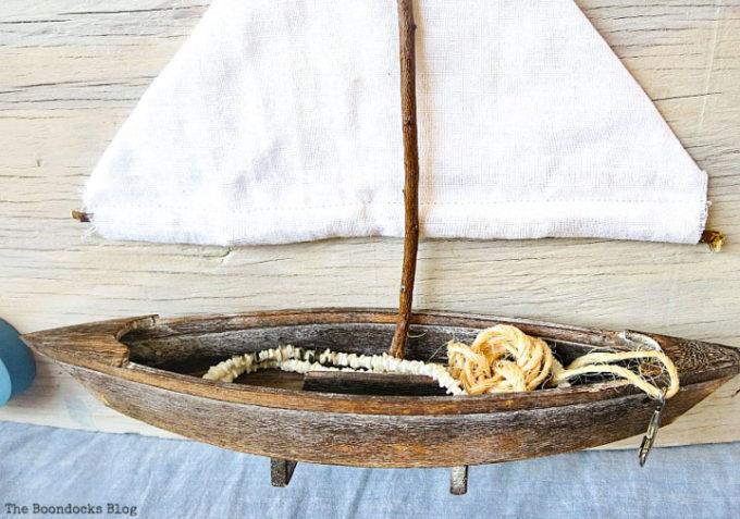 inside the boat, Seaside Art from a hidden treasure in the dresser / www.theboondocksblog.com